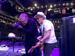 Roger Daltrey shows William Snyder a reflection of the video screen in one of the lights during The Who's soundcheck. The Who performs at The Barklay's Center during their The Who Hit 50 Tour in Brooklyn, NY on May 26th, 2015.